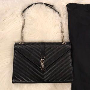 Saint Laurent large v flap monogram shoulder bag